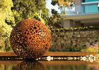 China Delicate Corten Steel Carved Hollow Ball Sculpture For Garden Decoration factory