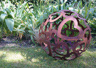 China Large Heart Pattern Corten Steel Sculpture Hollow Sphere Metal Garden Ball factory